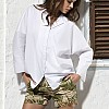 Shirt: Oska </br> Shorts: Bogner
